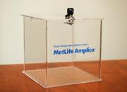 MetLife Amplico - Urna z pleksi